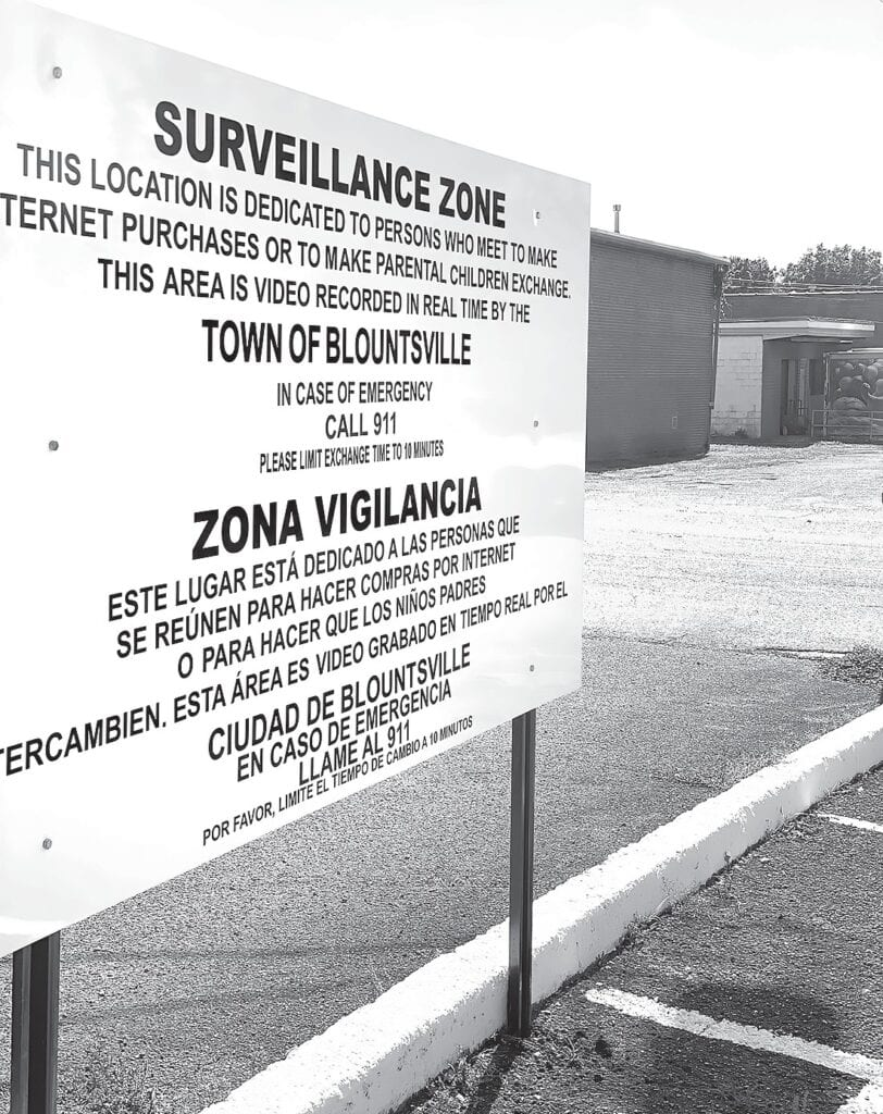 The Town of Blountsville installed the new sign for its Surveillance Zone dedicated to persons who meet for internet purchases or to exchange children in custody agreements. The zone is located across the street from Town Hall and the police department. It is under 24/7 camera surveillance.