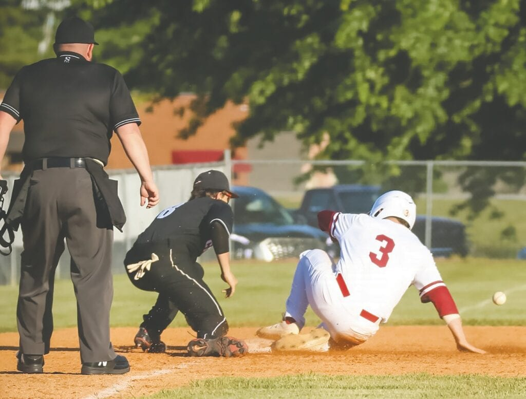 Oneonta's Brodie Devaney slides into third ahead of the throw in Friday's victory against North Jackson. -Mandy Moore Photography