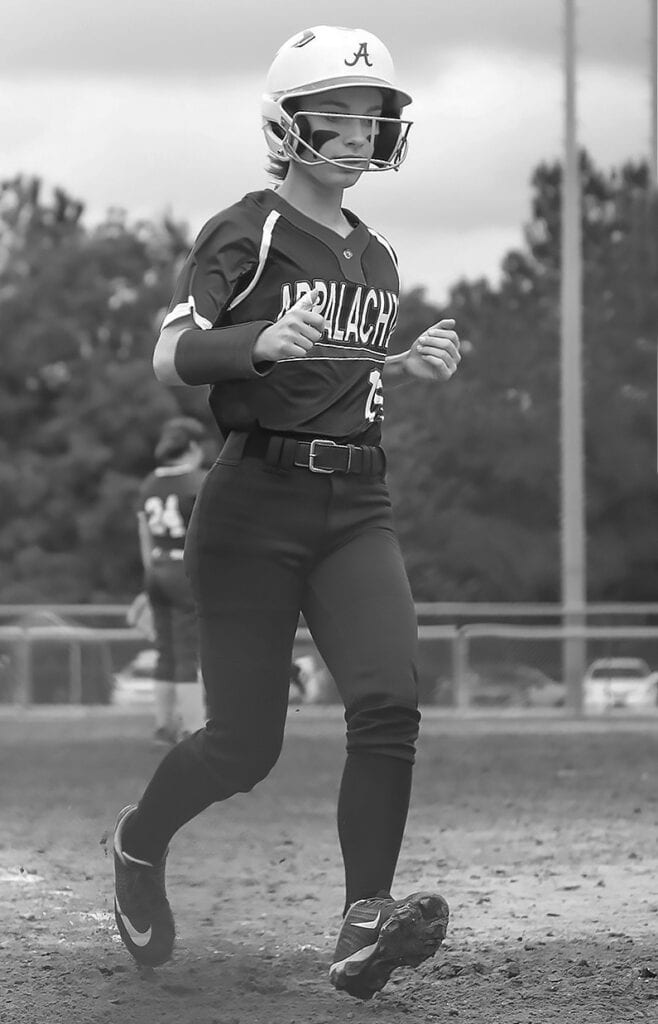 Appalachian's Stormy Stidham crosses the plate against Cedar Bluff. Stidham finished the game with one hit and one RBI. -Mandy Moore Photography