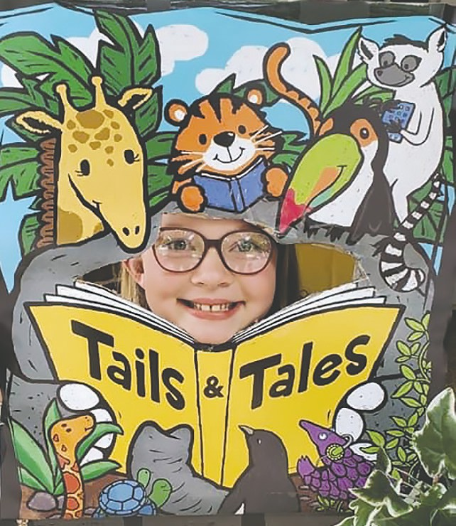 Smiles are the order of the day for the perfunctory photo with the Tails & Tales display at Blountsville Public Library. -Blountsville Public Library