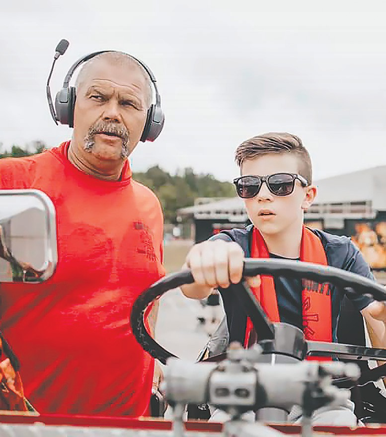 Assistant Fire Chief Jeff Ivey instructing cadet Solomon Oldham on tiller operations. -Samples Photo & Cinema