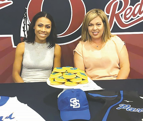 Aailyah Byrd (left) celebrates signing a softball scholarship with her mom Amanda Clem. -Donna Price