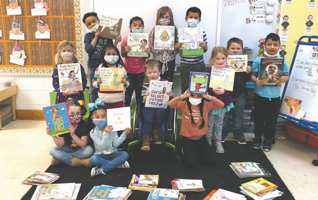 Students in Whitney Green's Susan Moore Elementary kindergarten class display books purchased with BCEF grant funds. See Green's letter page A11. -Whitney Green