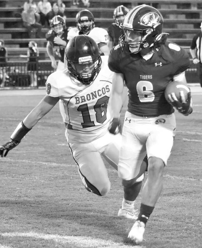 J.B. Pennington's Josh Marquez evades a Holly Pond defender and adds to his 94 rushing yards for the night. -Jennifer Cassity