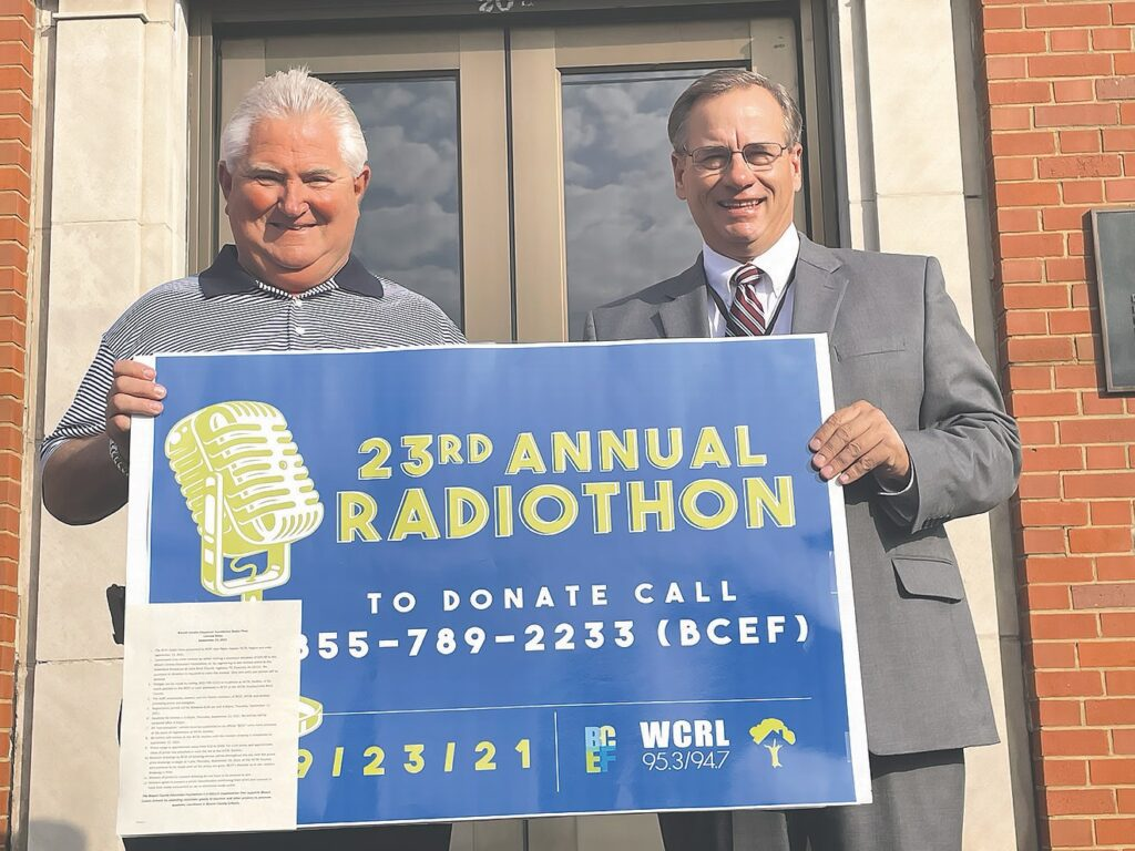 BCEF president Jeff Hallmark and BCS Superintendent Rodney Green make plans for the 23rd Annual Radiothon on Sept. 23. -Mitchie Neel