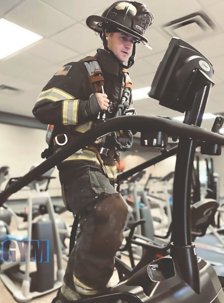 Oneonta firefighter Wesley Cox uses the stair climbing equipment in full turn-out gear as part of the 9/11 challenge. -courtesy Oneonta Fire & Rescue