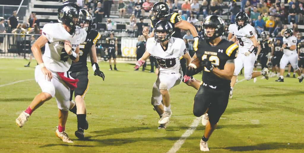 Cleveland's Pierce Gilliland (12) attempts to get around Southeastern's Trent Carpenter (2) as Jacob Johnson (5) and Cole Williams (20) close in. -Jeff Sargent